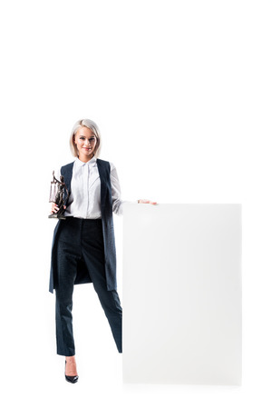 smiling lawyer with temida in hand standing at blank banner isolated on white