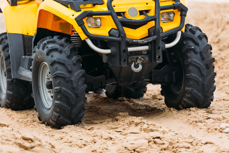 partial view of all-terrain vehicle on sand 스톡 콘텐츠
