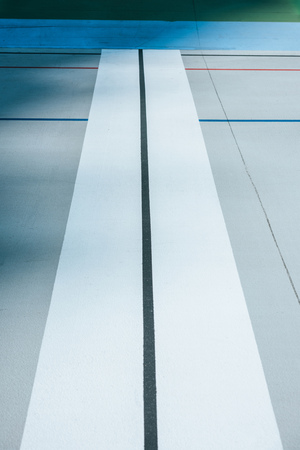 close-up view of lines on empty velodrome, urban geometric background