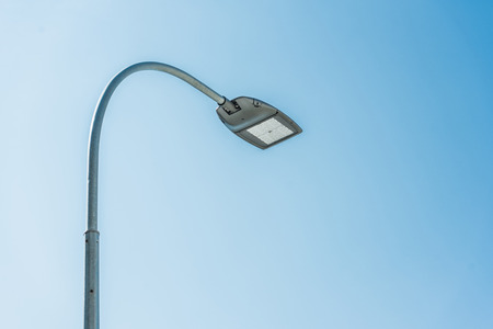 low angle view of street lamp against blue sky Stock Photo