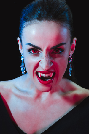 grim vampire looking at camera isolated on black Stock Photo