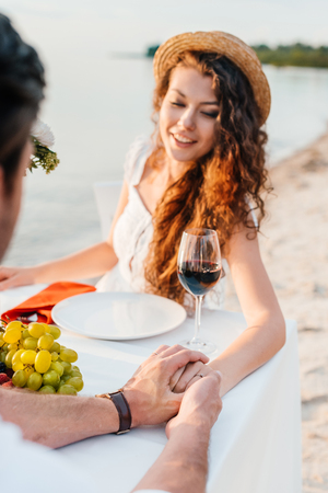 happy young couple holding hands after propose in romantic date outdoors Banco de Imagens