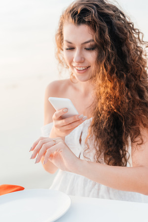 beautiful happy woman taking photo of engagement ring on her hand Stock Photo