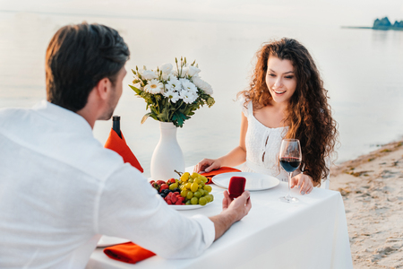 man making propose with ring to attractive woman in romantic date outdoors Stock Photo