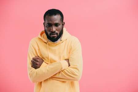 frustrated african american man with crossed arms isolated on pink background Stock Photo