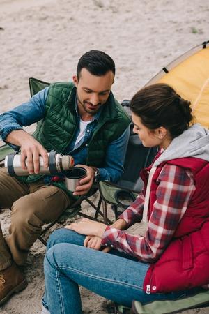 couple drinking hot tea during camping Standard-Bild - 110165551