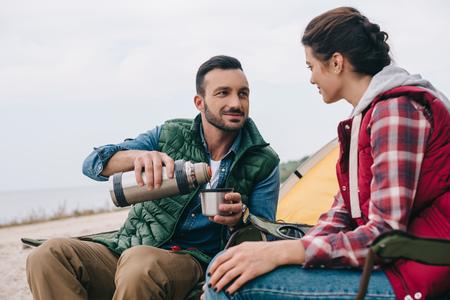 couple drinking hot tea during camping Standard-Bild - 110165552