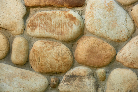 close-up view of weathered stone wall texture, full frame background