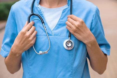 cropped image of medical student holding stethoscope on neck
