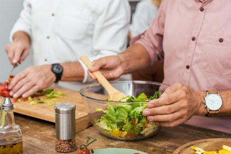 cropped image of men preparing salad for dinner at home Stok Fotoğraf