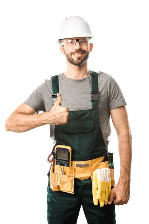 smiling handsome electrician showing thumb up isolated on white 免版税图像