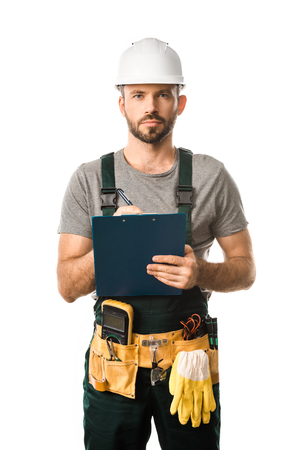 handsome electrician holding clipboard and looking at camera isolated on white