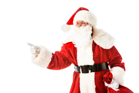 santa claus pointing on side while looking at camera isolated on white Stock Photo