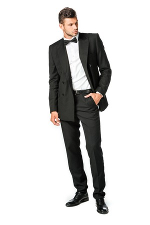 handsome young man in black suit looking away isolated on white Stock fotó