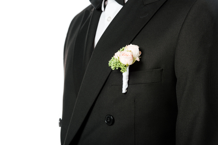 cropped shot of groom in stylish suit with beautiful boutonniere isolated on white