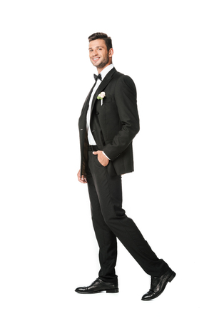 handsome young groom in stylish suit isolated on white Stock Photo