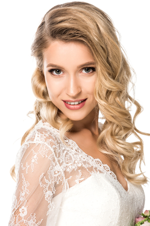 close-up portrait of beautiful young bride looking at camera isolated on white
