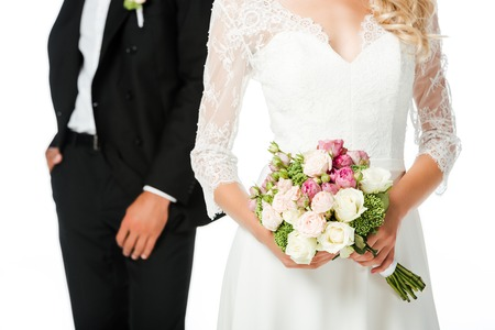 cropped shot of bride with bouquet and groom isolated on white Stock fotó