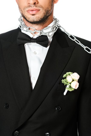 cropped shot of groom with boutonniere and chain tied around neck isolated on white
