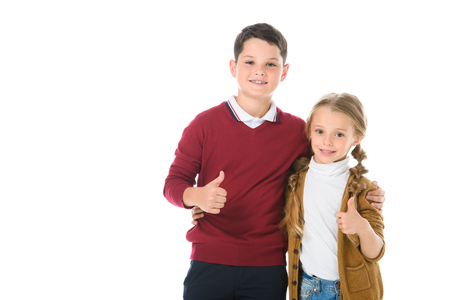 siblings hugging and showing thumbs up, isolated on white