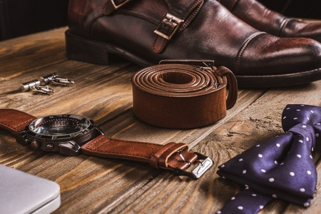 close up view of leather male accessories and shoes arranged on wooden tabletop 版權商用圖片