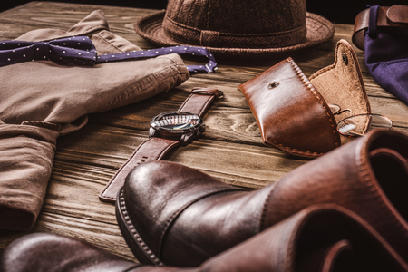 close up view of arrangement of masculine stylish shirt  and accessroies on wooden tabletop Banco de Imagens