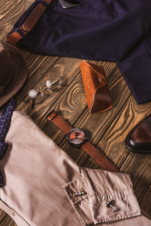 close up view of arrangement of masculine stylish clothing and accessroies on wooden tabletop 스톡 콘텐츠