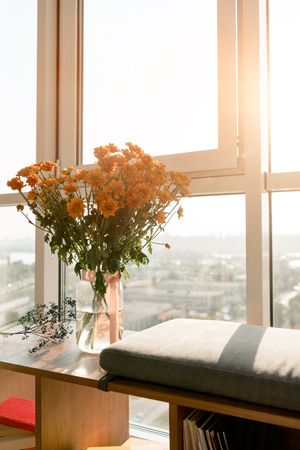 close up view of beautiful bouquet of flowers standing at window