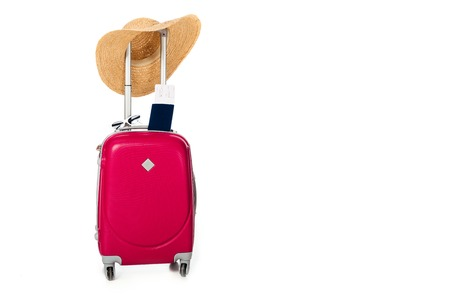 close up view of pink suitcase, straw hat, passport and ticket isolated on white Imagens
