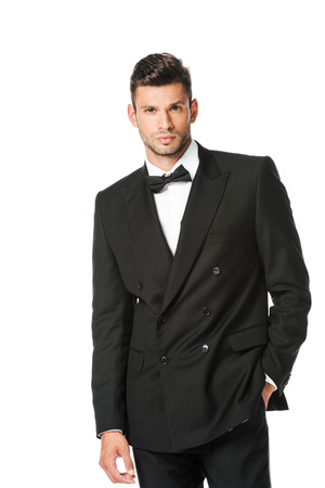 stylish young man in black suit looking at camera isolated on white