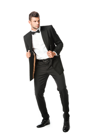 handsome young man posing in black suit isolated on white Stock fotó