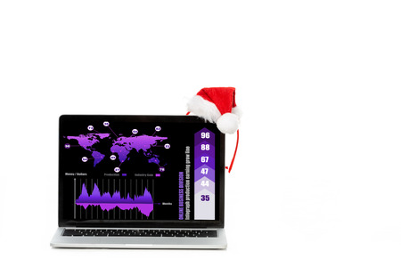christmas hat on laptop with infrographic on screen isolated on white background Stock Photo