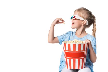 child eating popcorn isolated on white