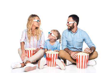family with popcorn and 3d glasses isolated on white