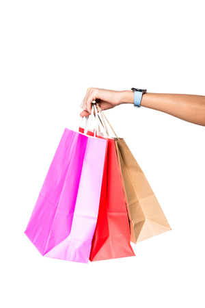 woman holding shopping bags isolated on white Stockfoto