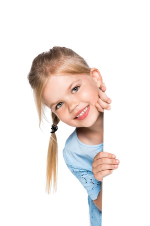 smiling child with empty board isolated on white
