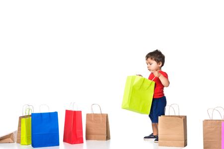 boy holding shopping bag isolated on white . Archivio Fotografico - 112355109