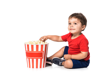 happy boy with popcorn isolated on white
