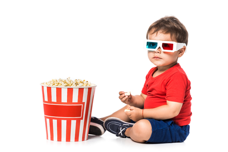 kid with popcorn and 3d glasses isolated on white