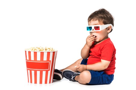 boy eating popcorn and 3d glasses isolated on white Stock Photo