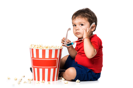 boy with popcorn and 3d glasses isolated on white