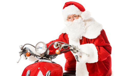 santa claus with vintage red scooter looking at camera isolated on white 免版税图像