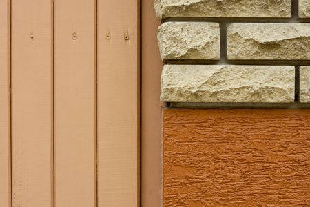 close-up view of bricks, rough wall and wooden planks background Reklamní fotografie