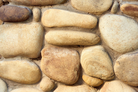 close-up view of rough stone wall texture, full frame background Imagens