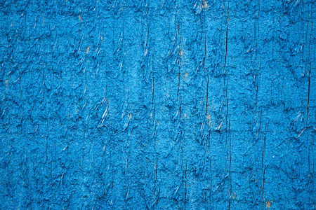 old bright blue weathered wooden background