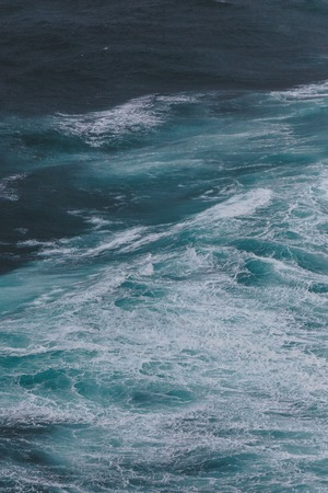 dramatic shot of ocean with foamy waves for background