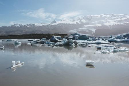 scenic shot of melting glacier ice floating in lake in Fjallsarlon, Iceland Stok Fotoğraf