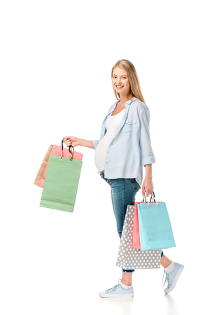 happy pregnant woman with shopping bags isolated on white Foto de archivo - 109837631