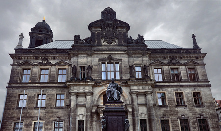 Facade of High Regional Court of Dresden with monument of Frederick Augustus I in Dresden, Germany