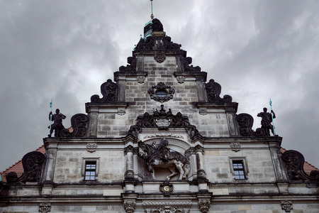 low angle view of top of old Dresden Cathedral with statues against grey sky in Dresden, Germany Banco de Imagens